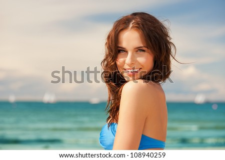 bright picture of happy smiling woman on the beach. - stock photo