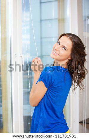 bright picture of happy woman at the window - stock photo