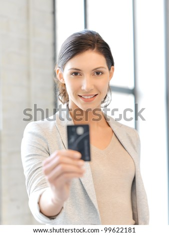 bright picture of happy woman with credit card - stock photo