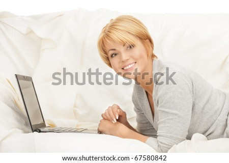 bright picture of happy woman with laptop computer - stock photo