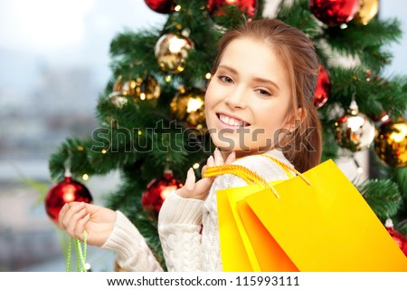 bright picture of happy woman with shopping bags and christmas tree..... - stock photo