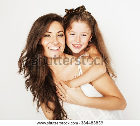 bright picture of hugging mother and daughter happy together, smiling stylish family. - stock photo