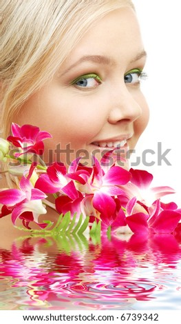 bright picture of lovely blond with orchid in water