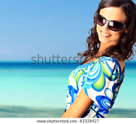 bright picture of lovely brunette woman at the sea