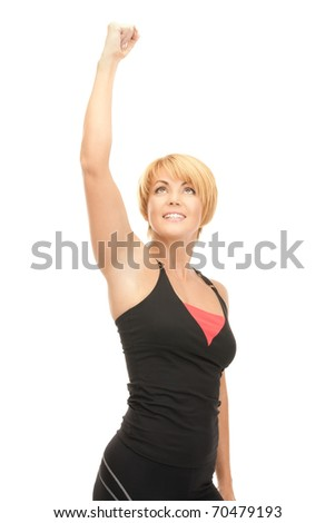 bright picture of lovely fit woman with expression of tryumph over white - stock photo