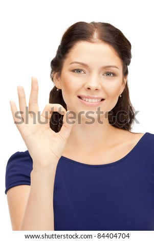 bright picture of lovely teenage girl showing ok sign