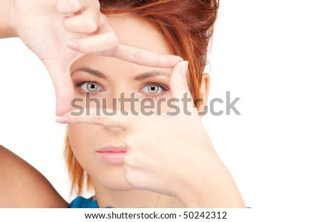 bright picture of lovely woman creating a frame with fingers - stock photo