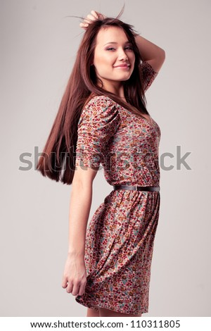 bright picture of lovely woman in elegant dress - stock photo