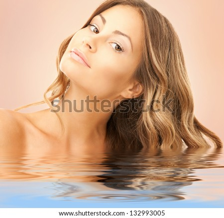 bright picture of lovely woman over beige - stock photo