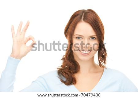 bright picture of lovely woman showing ok sign - stock photo