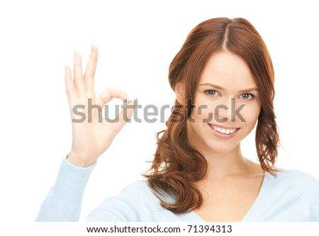 bright picture of lovely woman showing ok sign
