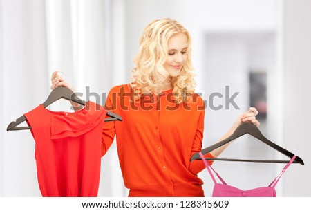 bright picture of lovely woman with clothes - stock photo