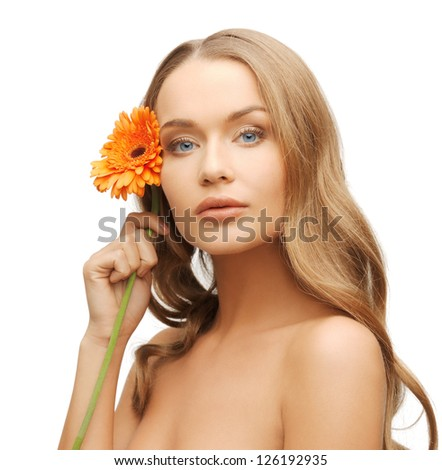 bright picture of lovely woman with gerbera flower.