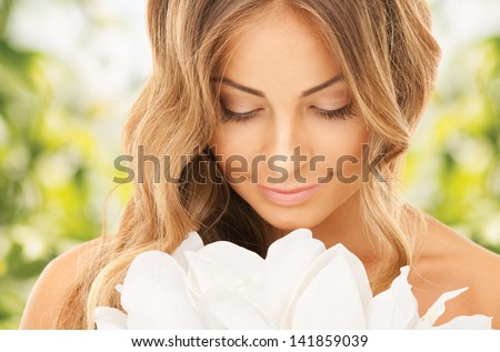 bright picture of lovely woman with lily flower - stock photo