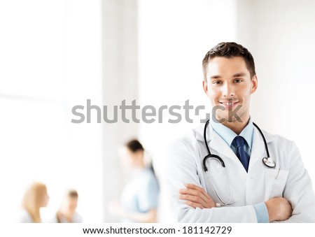 bright picture of male doctor with stethoscope - stock photo