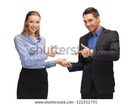 bright picture of man and woman making a gun gesture