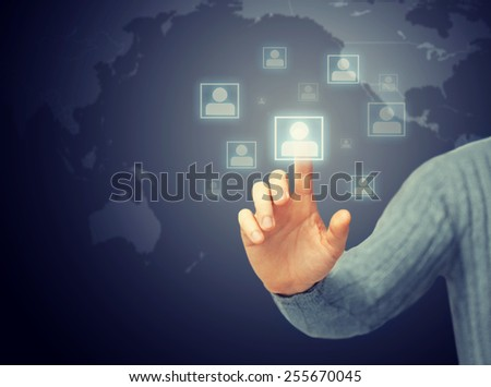 bright picture of man pressing imaginary button - stock photo