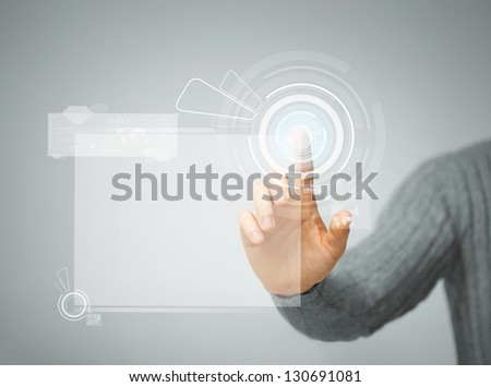bright picture of man pressing virtual button - stock photo