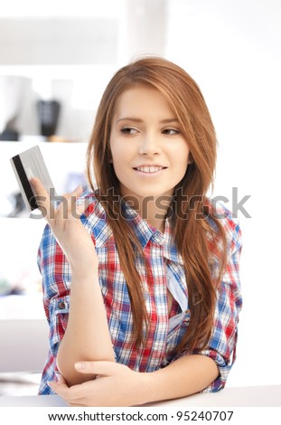 bright picture of pensive woman with credit card - stock photo