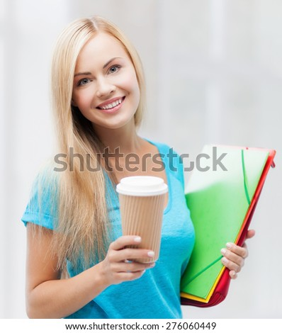 bright picture of smiling student with folders and cup of coffee - stock photo