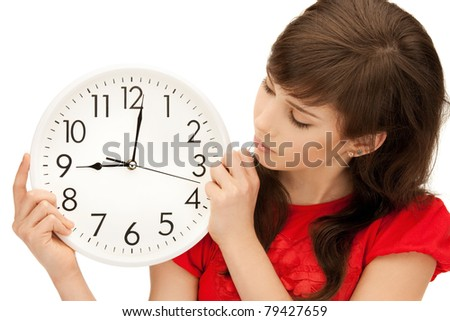 bright picture of teenage girl holding big clock