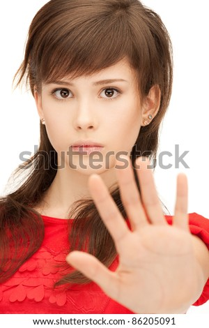 bright picture of teenage girl making stop gesture - stock photo