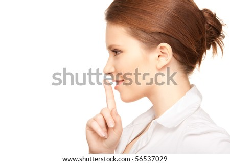 bright picture of teenage girl with finger on lips - stock photo