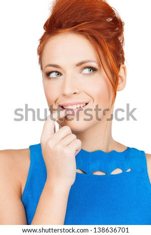 bright picture of thoughtful woman holding finger in her mouth - stock photo
