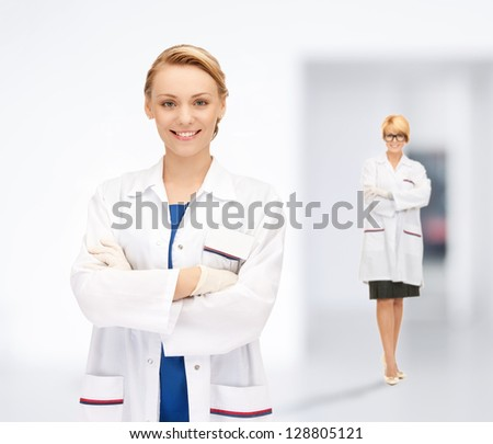 bright picture of two attractive female doctors - stock photo