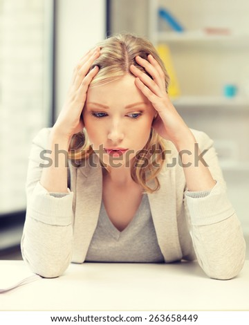 bright picture of unhappy woman in office - stock photo