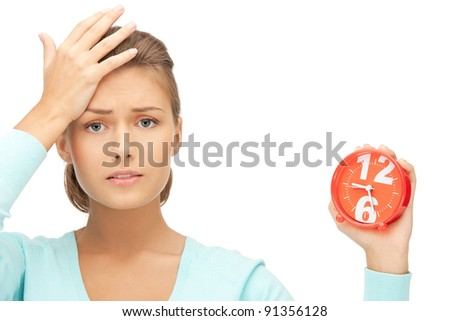 bright picture of woman holding alarm clock - stock photo