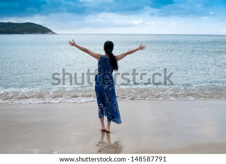 bright picture of woman on the beach.