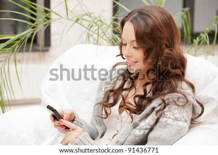 bright picture of woman with cell phone - stock photo