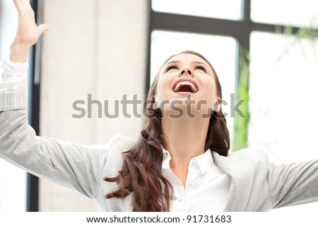 bright picture of woman with expression of triumph