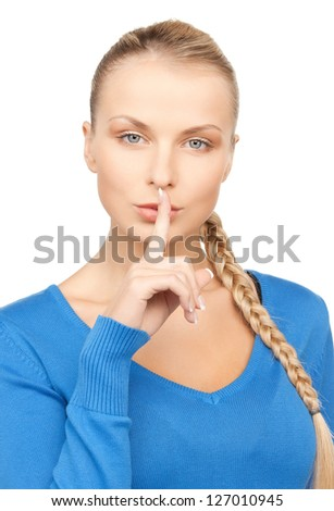 bright picture of woman with finger on lips - stock photo