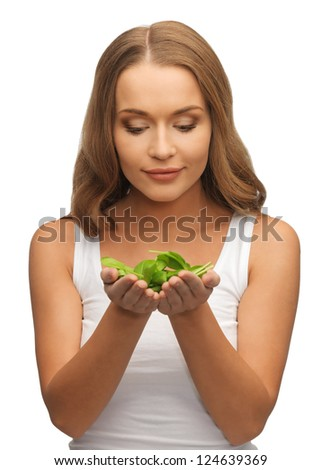 bright picture of woman with spinach leaves on palms