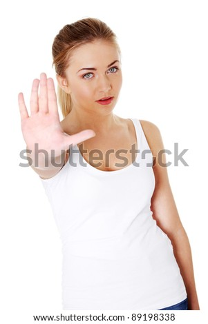 Bright picture of young woman making stop gesture. - stock photo