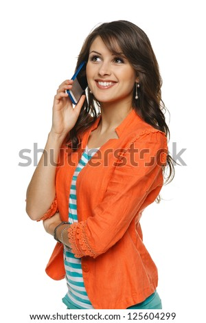 Bright picture of young woman talking on cellphone, looking up, over white background - stock photo