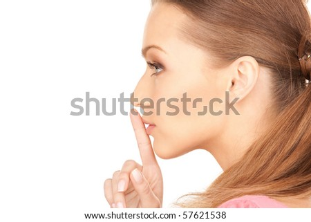 bright picture of young woman with finger on lips - stock photo