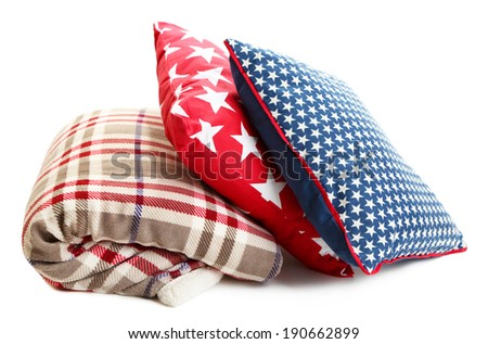 Bright pillows and plaid isolated on white