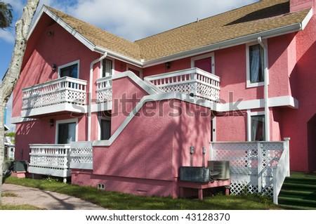 Bright pink Abandon condominium due to recession - stock photo