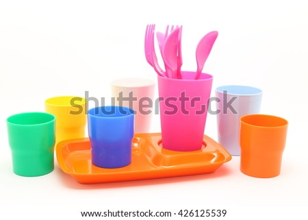 bright plastic disposable tableware  on white background