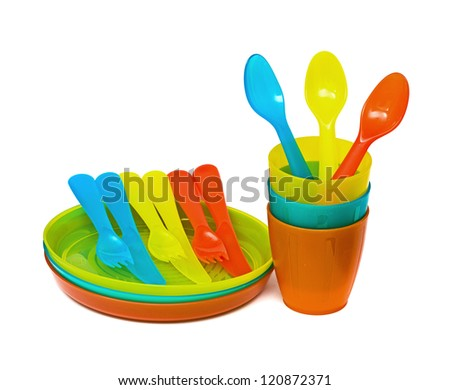 Bright plastic tableware isolated on white