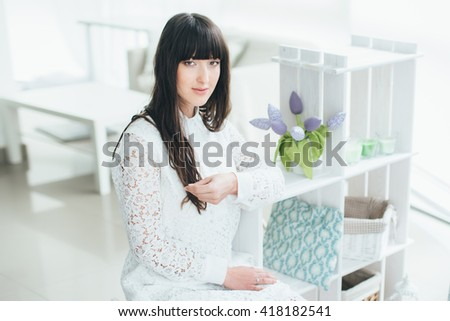 Bright portrait of a charming girl. Beautiful girl in a bright room