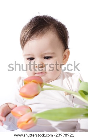 bright portrait of a cute baby with flowers