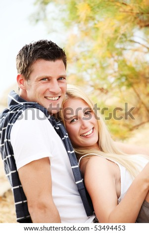 Bright portrait of a happy young couple. Shallow DoF with focus on the woman.