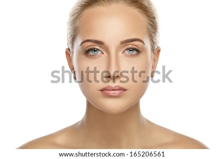 Bright portrait of a young girl. Nude makeup.