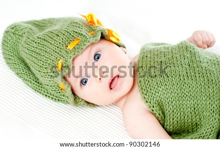 bright portrait of adorable baby in the cap - stock photo