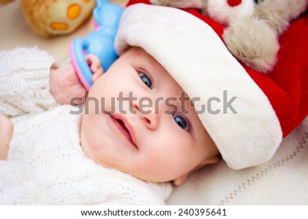 bright portrait of adorable baby , Santa hat portrait at room - stock photo