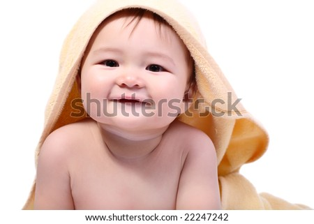 bright portrait of adorable smiling baby wrapped in towel over white background - stock photo